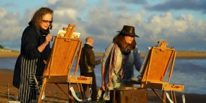 Artists Wendy Kimberley and Sally Usher, Andrew Horrod in the background, painting at Paint Out Wells beach sunrise. Photo by Katy Jon Went