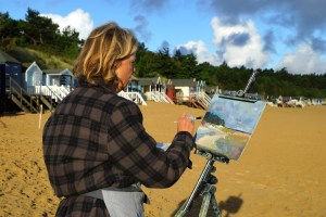 Artist Sarah Muir Poland painting at Paint Out Wells beach sunrise. Photo by Katy Jon Went