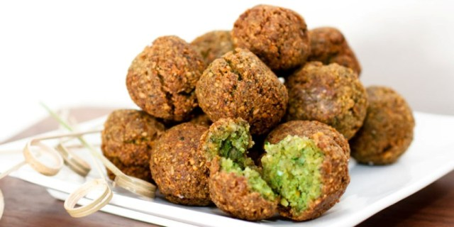 """falafel is a deep-fried ball or patty made from ground chickpeas, fava beans, or both. Falafel is a traditional Middle Eastern food, commonly served in a pita, which acts as a pocket, or wrapped in a flatbread known as lafa; """"falafel"""" also frequently refers to a wrapped sandwich that is prepared in this way. The falafel balls are topped with salads, pickled vegetables, hot sauce, and drizzled with tahini-based sauces. Falafel balls may also be eaten alone as a snack or served as part of a meze (appetizers)."""