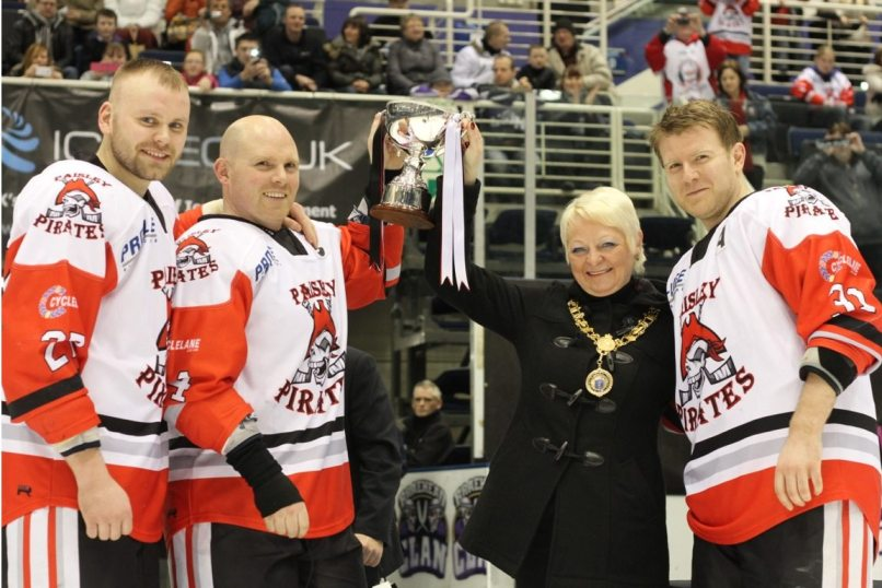 Provost Anne Hall presenting the SNL Trophy to Team Captain John Churchill, flanked by Alternate Captains Chris Turley (on the left) and Mark Hassan (on the right)