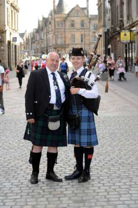dep provost John Caldwell with Greg Harley 18 Johnstone Pipe Band