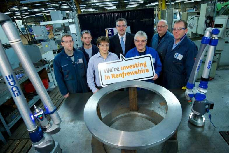 Councillor Macmillan and David with some of the Reekie Machining staff.