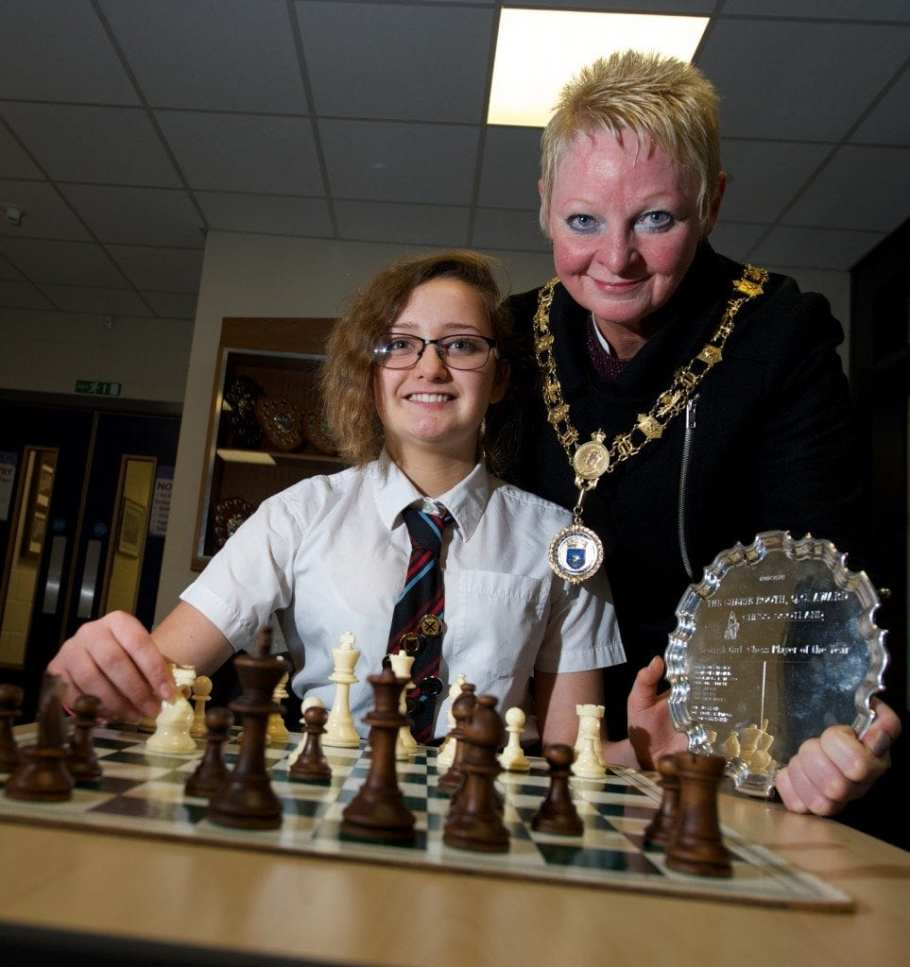 Caitlin Reid shows Renfrewshire's Provost Anne Hall some chess moves.