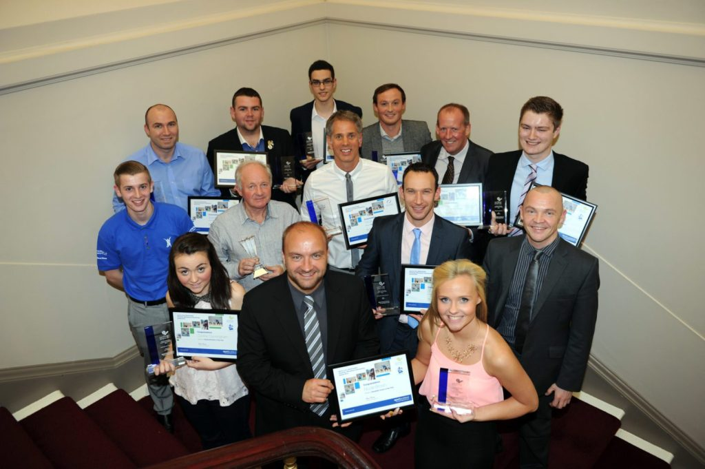 Cllr Stuart Clark, Depute Convener of Sport, Leisure and Culture Board, with award winners in Paisley Town Hall