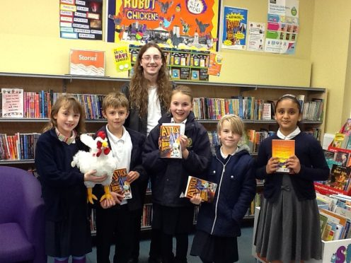 Children's Author Alex McCall and Johnstone Library Book Group with his book Attack of the Giant Robot Chickens