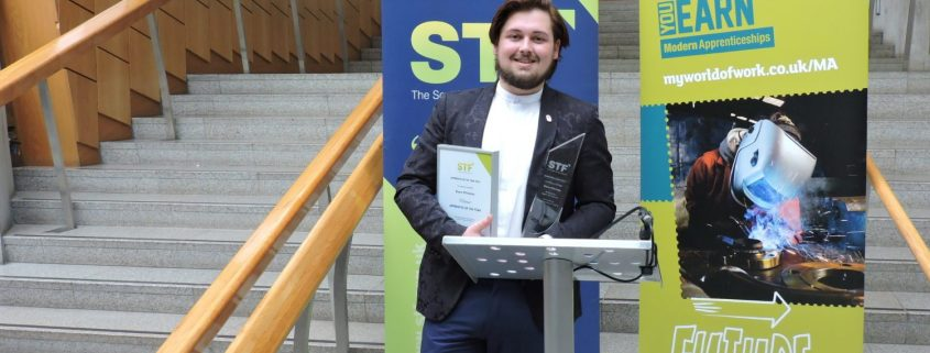 Reece with his Trophy at Hse of Parliament Edinburgh.JPG