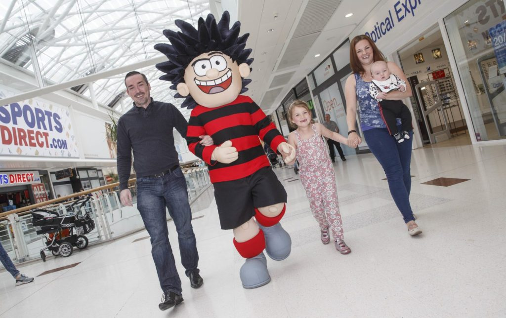 Dennis the Menace intu Braehead Glasgow  Dennis the Menace with l-r Gareth Chalmers , Daughter Emma 7 , Mother Stephenie , 5 month Spencer