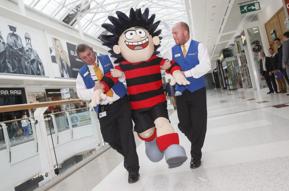 Dennis the Menace intu Braehead Glasgow Dennisbeing frogged marched out of the Shopping centre by security . l-r Thomas McEwan , and Gareth Gillies