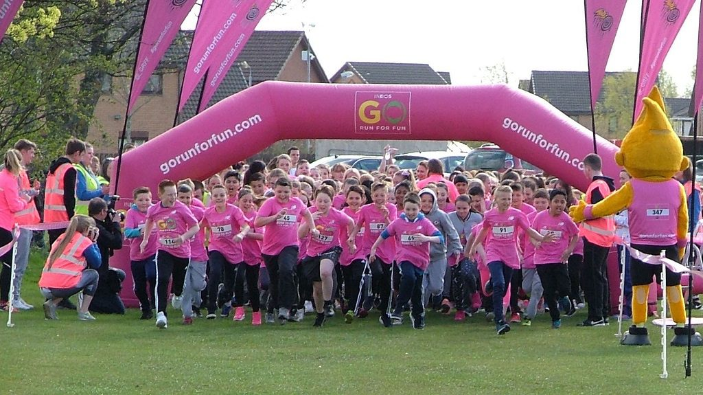 On your marks…the fun runners head off round the course.
