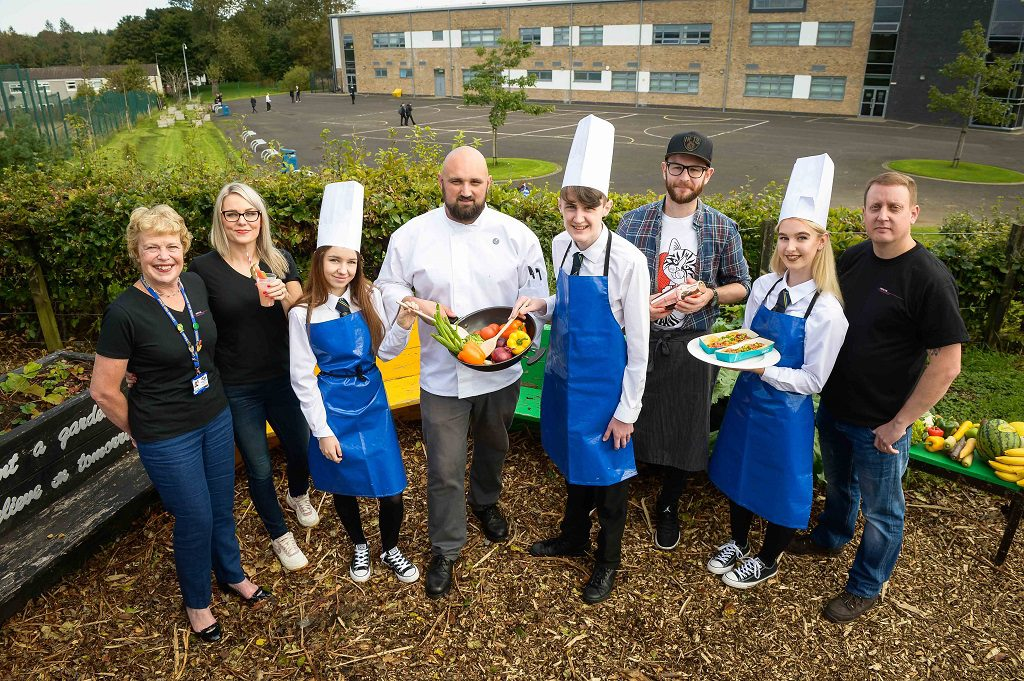 (L-R) Linwood High School Head Teacher Eileen Young, Director of the TTA Stephanie Wade, pupil Necole Wilson (14), Kained Holdings Group Development Chef Scott Leask, pupil Evan Thompson (17), Kyle Steel of pop-up restaurant Section 33, pupil Emile McEwan (14) and Tree of Knowledge Director Dougie Clark at the Taste the Industry event at Linwood High School