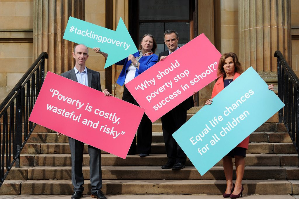 (l to r) Renfrewshire Tackling Poverty commissioners Dr Jim McCormick, Prof Sue Ellis (University of Strathclyde), Cllr Mike Holmes and Dr Linda de Caestecker (NHS Greater Glasgow and Clyde director of public health)