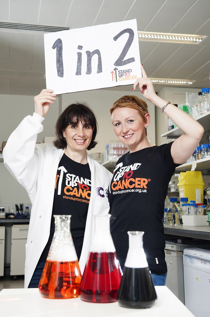 (L-R) Yvette Hutcheson and Dr Karen Blyth. Cancer survivor Yvette Hutcheson and Scientist Dr Karen Blyth at the Beatson Institute, Glasgow. Stand Up to Cancer (SU2C) campaig. SU2C is an annual joint fundraising campaign from Cancer Research UK and Channel 4 to fund cancer research. This year's campaign will culminate on Friday 21 October with a night of live TV entertainment on Channel 4. All money payable:- Mark Anderson Flat 2/2 Glasgow G41 3HG