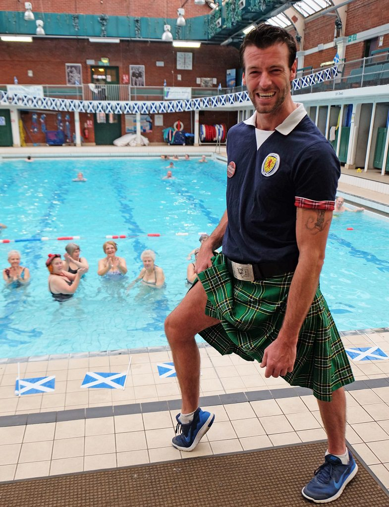 The ladies in the pool enjoyed seeing staff member, Paul Caruth in his kilt