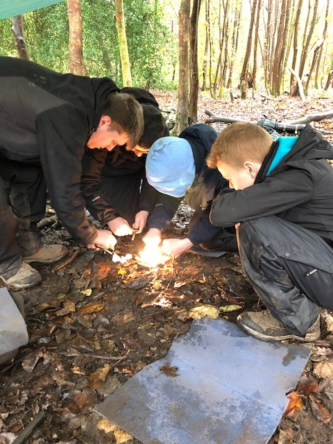 Pupils at Castlehead High learn how to start a fire as part of 'Forest School'