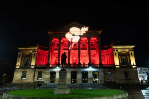 Paisley Town Hall lit up in red