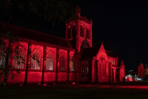 Pasiley Abbey lit up in red