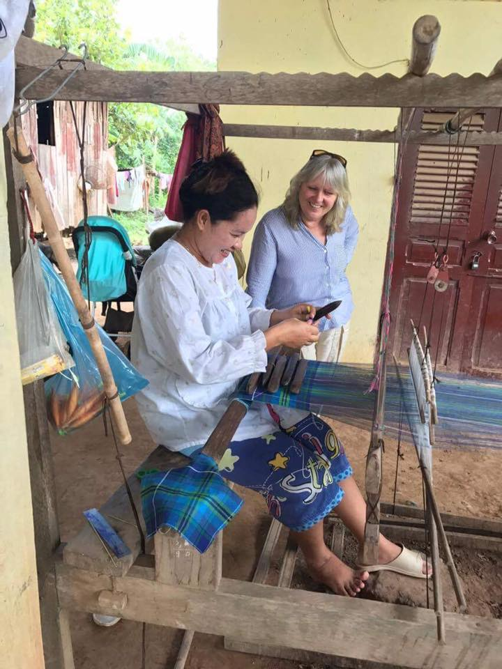 Eve Broadis with master weaver in Cambodia