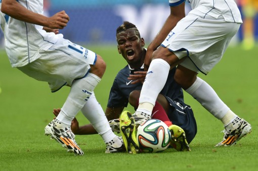 Crunch Time! The Hondurans demonstrate their 'robust' tackling style on Pauvre Petit Pogba