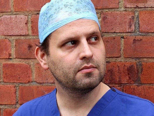 Adam Kay dressed in hospital scrubs in This is Going to Hurt at the Palace Theatre, London