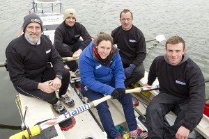 Olympic gold medal rower Sophie Hosking with her father David and the crew of Hallin Marine 2. Photograph: onEdition