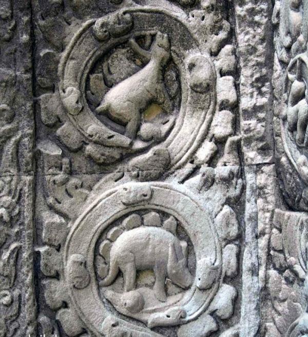 Mammal above alleged stegosaurus carving