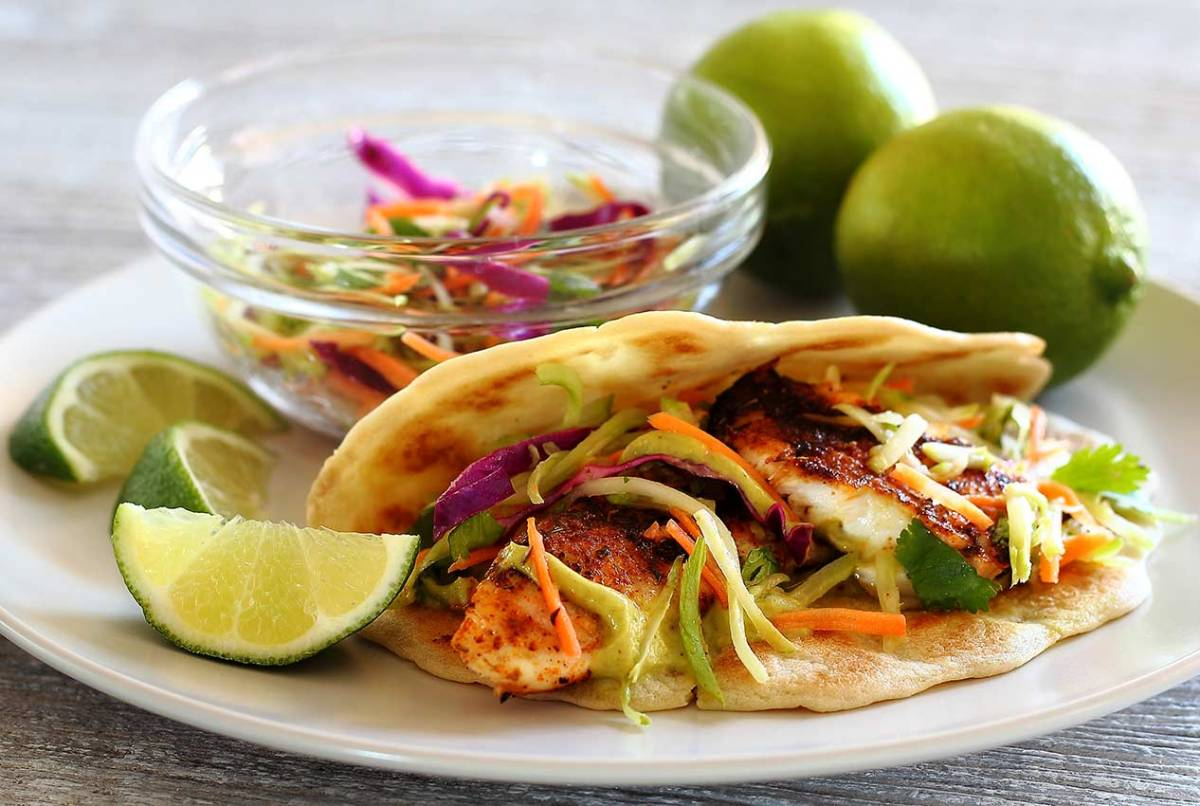 Easy paleo recipe for fish tacos with lime slaw and avocado sauce