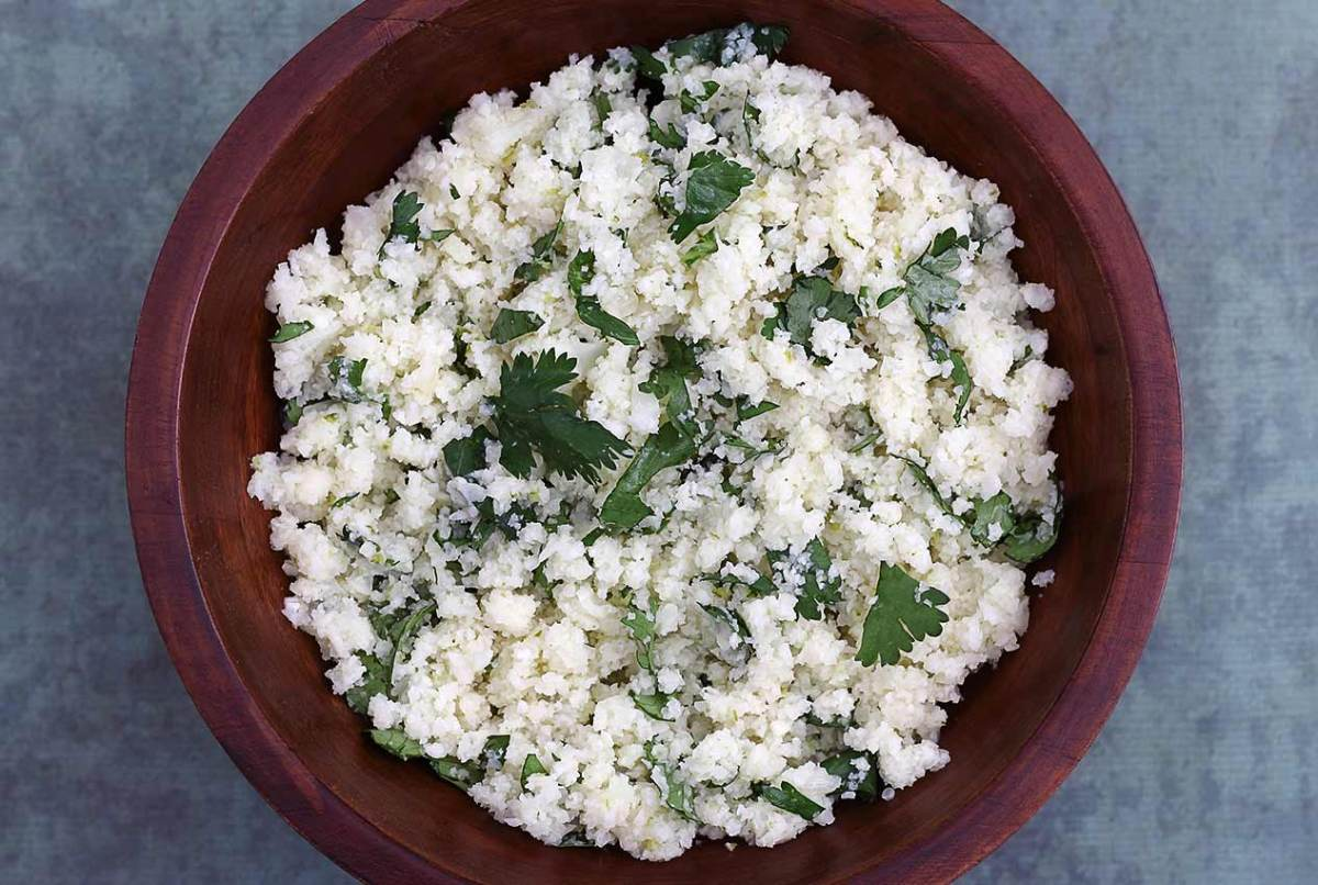 easy recipe for a grain-free rice using cauliflower and flavored with cilantro and broth