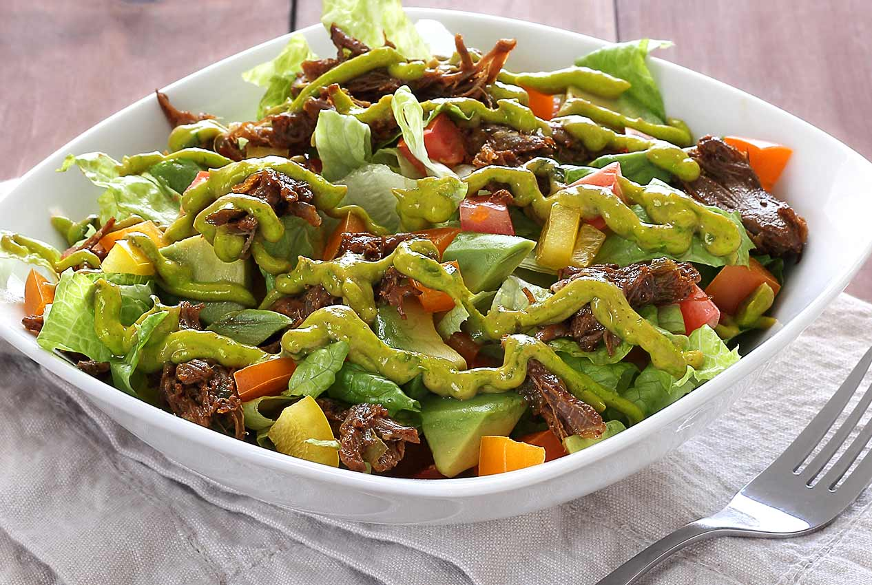 easy paleo recipe for slow-cooked beef salad with avocado sauce