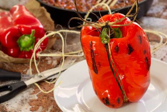 A different way to enjoy stuffed peppers -- grilled with the cooked sausage and ground beef mix stuffed inside