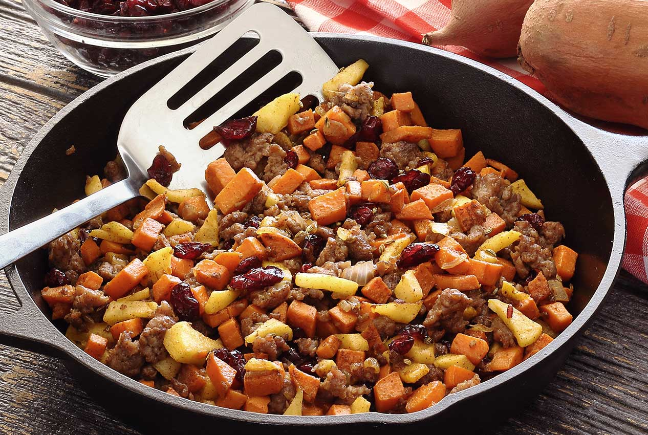 easy paleo recipe for a hearty hash with sausage, potato and cranberries