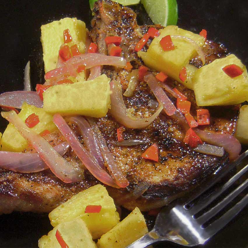 grilled pork chops with a pineapple chili pepper salsa