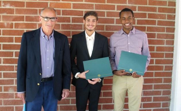 Optimist Dan Ackerman presented scholarships to Ethan Acevedo and Biniyam Asnake (right).