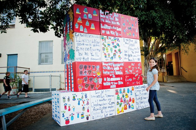 """Second grader Sage Denham participated in the Art Cadre project—a giant """"Cat in the Hat"""" consisting of the children's drawings, based on the art of Dr. Seuss and Dr. Seuss' sayings. Photo: Lesly Hall"""