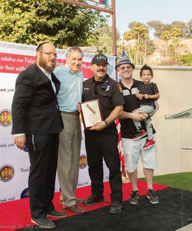 Rabbi Zushe Cunin, Chamber of Commerce Executive Director Arnie Wishnick, Station 23 Fire Fighter John Sullivan, and event sponsor Darren Enenstein and son Max.