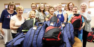 Members of the Assistance League supplied 870 backpacks. Palisadian Mary Ann Lessin is second from the left in the green shirt.