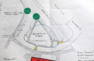 The blue circle is the existing island in front of the old gym. A new design would be more triangular in shape and allow for additional parking spaces and crosswalks at the Recreation Center.