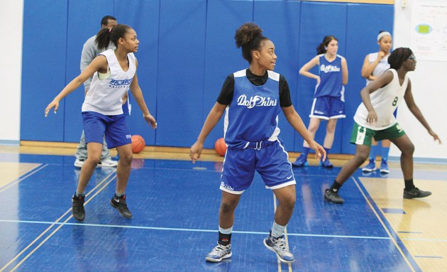 From left to right, Kayla Williams, Chaniya Picket and Jane Nwaba during practice at Palisades High. In the rear, Lea Toubian and Brooke Messaye are on the baseline. Photo: Bart Bartholomew