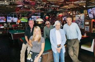 Members of the lunch club (left to right), Bob Vickrey, Barry Stein, Josh Greenfeld and Arnie Wishnick, pose with their waitress, Whitney. Photo: Barry Stein