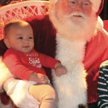 This tiny lad was one of many who sat on Santa's lap. Photo: Bart Bartholomew