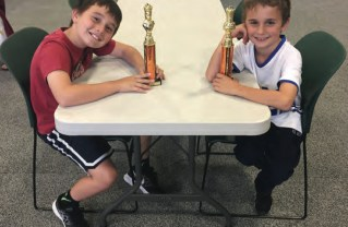 Village School students Ben Shaheen (left) and Mason Rufeh took first place in a Westside chess tournament.