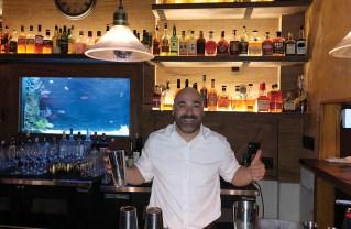 Bartender Daniel Baker keeps the drinks flowing at the Golden Bull.