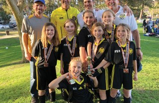 At the awards ceremony for the Beverly Hills Sportsmanship Cup were (back row left to right) Coach Jonathon Eastman and referees Dick Held, Brian Held and Tim Reuben; (middle row) Declan Eastman, Maya Eisner, Becca Reuben, Molly Held, Ophelia Soule and Harlowe Hranek; (front) Ingrid Knapp. Not pictured: Coach Matt Humiston, Francesca Moreno, Rachel Humiston, Jordan Roth, Hailey Sugarman, Amanda Wexler and Siena Wolfson.