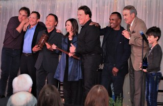 Pacific Palisades Honorary Mayors (left to right) Kevin Nealon, Steve Gutenberg, Billy and Janice Crystal, Jake Steinfeld and Ray Leonard, joined together to honor Arnie Wishnick. Also on hand was Gable Nealon (far right).