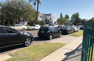 Cars park in driveways and in the red, causing chaos during Revere school dismissal.