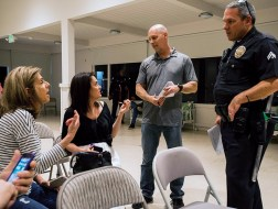 Officer Michael Moore (right) listens to Palisades residents as they tell their stories of experienced crime at a community meeting in the Women's Club on Jan. 29, 2018. September Dawn Bottoms/ For the Palisades News