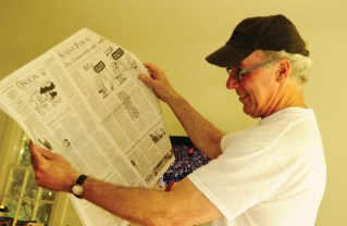 Bob Vickrey delights in his daily newspaper. Photo: Barry Stein