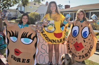 Three Girl Scouts from Troop 565, Claire Sibson, Darby Rhastager and Sage Denham, have cookies for sale (through March 11)