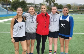 This year's co-captains (left to right) Ally Stahl, Rachael Smuts, Deryn Greene and Sammy Stahl provide support to Coach Betsy Economou (center).