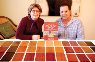 Marci Crestani and Brian Miller, co-authors of The Art of Coloring Wood, with their book and some of the many samples they colored to illustrate it. Photo: Bob Crestani