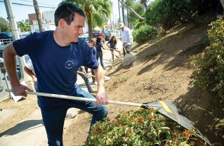 Caruso's Michael Gazzano works up a sweat cleaning the weeds and trash that had accumulated along Swarthmore. The Caruso team was joined by Dirty Girl Organic Landcare workers and members of Palisades PRIDE. Photo courtesy of Caruso